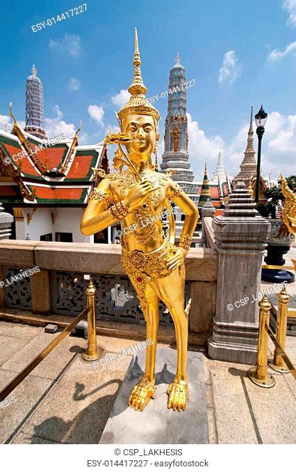 Golden Kinnari statue at Temple of Emerald Buddha