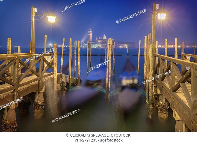 Europe, Italy, Veneto, Venice. Night landscape towards the island of San Giorgio with the gondolas