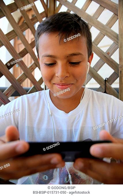 11-year-old boy using a cell phone in Salento, Italy