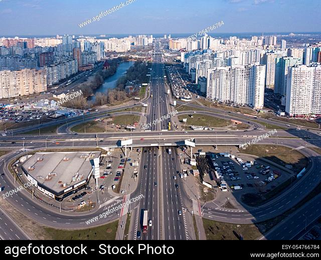 Aerial panoramic photography from the drone, bird's eye view to Pozniaky district, Mykoly Bazhana Ave with traffic and modern building of the city Kiev Ukraine...