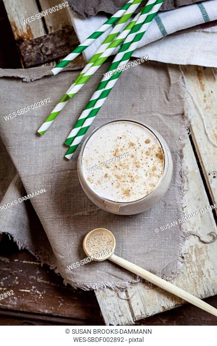 Glass of cheesecake smoothie with tigernut powder