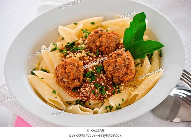 Pasta with tomato garlic sauce and meatballs