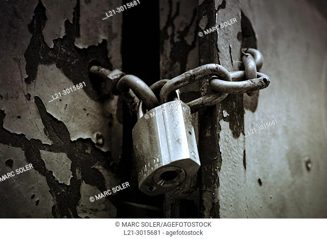 Padlock and chain on old door