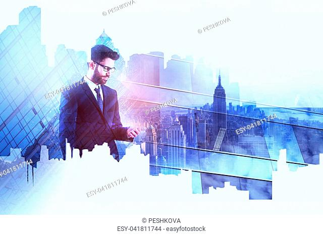 Portrait of attractive young businessman using smartphone on abstract city background. Technology and communication concept. Double exposure