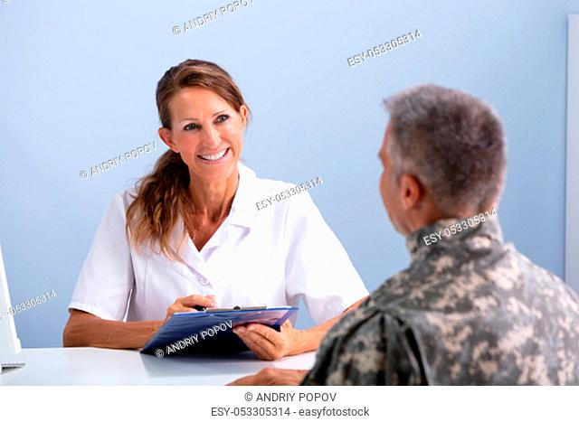 Army Soldier During Session At Doctor's Clinic