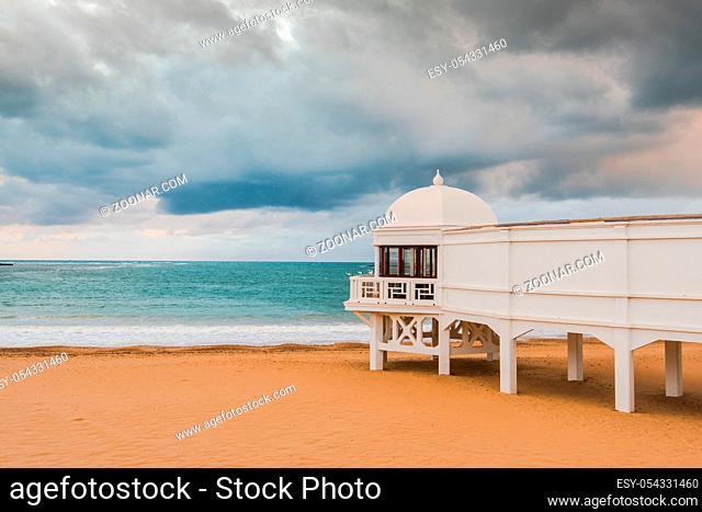 Romantic sunset at Cadiz beach with famous pier