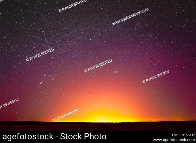 Colorful Night Sky With Glowing Stars Background Backdrop. Sky Gradient. Sunset, Sunrise Lights And Colourful Night Starry Sky In Yellow Pink Magenta Orange...