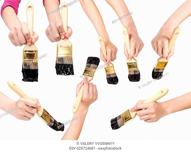 set of painter hands with flat paint brushes with black painted tips isolated on white background