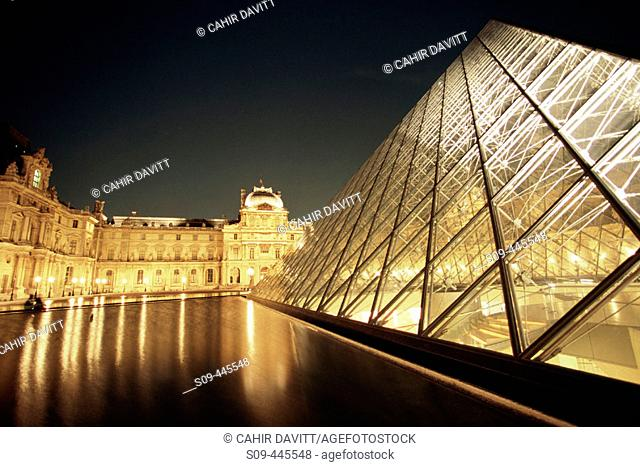 Pyramid of the Grand Louvre art museum and Cour Napoleon by night, Paris. France