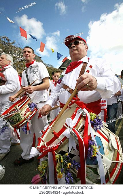 Drummers supporting the Red Oss, Padstow Obby Oss, May day, Padstow, Cornwall, UK
