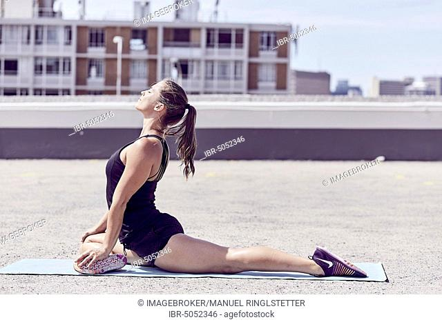 Young woman at gymnastics exercises, athletic, South Africa, Africa