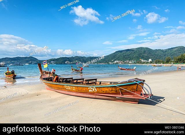 Phuket, Thailand Traditional longtail boats on the shore of Patong beach at Andaman sea, Phuket island in Thailand