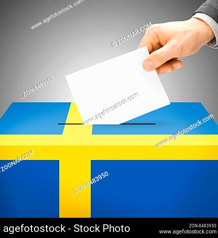 Voting concept - Ballot box painted into national flag colors - Sweden
