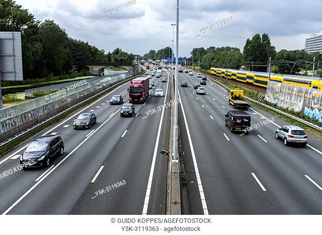 Rotterdam, Netherlands. The A20 elevated highway, alongside the north of Rotterdam with it's buzy traffic, seen wwestbound