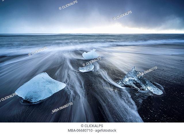 Ice blocks on the black sand beach in Jokulsarlon Glacier Lagoon, Eastern Iceland, Europe
