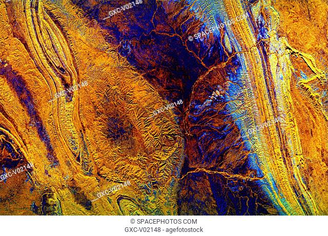 This spaceborne radar image shows mountains and valleys in the arid landscape of central Australia. The mountains are part of the MacDonnell Ranges in the...