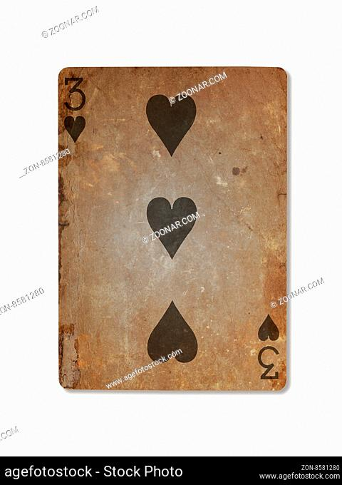 Very old playing card isolated on a white background, three of hearts
