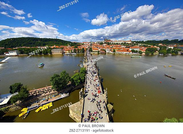 St. Vitus Cathedral and Prague Castle skyline with the Charles Bridge over the Vltava River in Prague, Czech Republic
