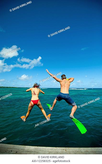Snorkellers jumping into the waters off Uplulu Island; Upulu, Samoa