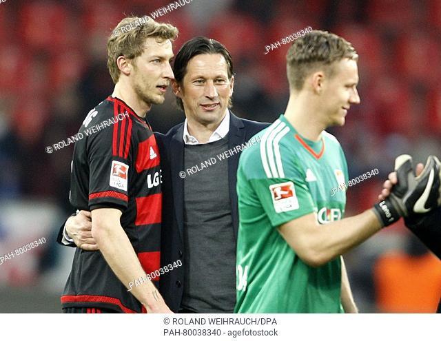 Leverkusen's head coach Roger Schmidt (C) celebrates with players Stefan Kiessling (L) and Bernd Leno after theGerman Bundesliga soccer match between Bayer 04...