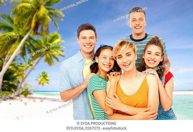 happy friends over tropical beach background