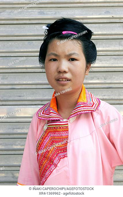 Portrait of woman in traditional clothes, Market Rongjiang, Rongjiang, Guizhou, China