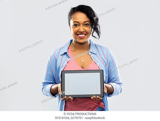 happy african american woman showing tablet pc