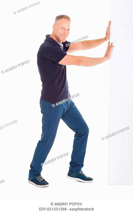 Confident Man Pushing Billboard