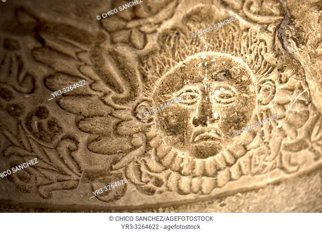 A sun carved on a stone decorates a church in Oaxaca, Mexico