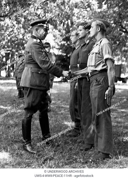 Loire River, France: September 18, 1944.German Major General Erich Elster shakes hands with a cross section of his 19,000 men that he surrendered to the...