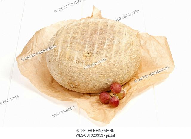 French Bethmale cheese and grapes on greaseproof paper