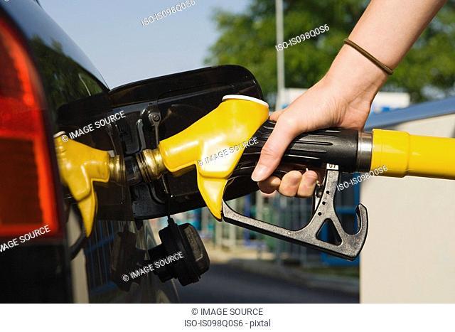 Person using petrol pump