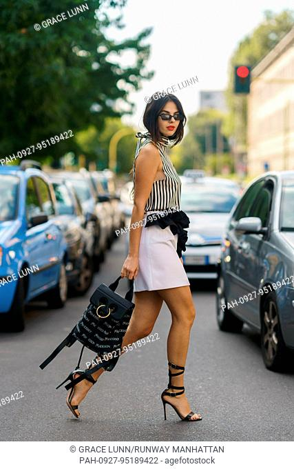 Blogger Doina Ciobanu posing outside of the MSGM runway show during Milan Fashion Week - Sept 24, 2017 - Photo: Runway Manhattan/Grace Lunn ***For Editorial Use...