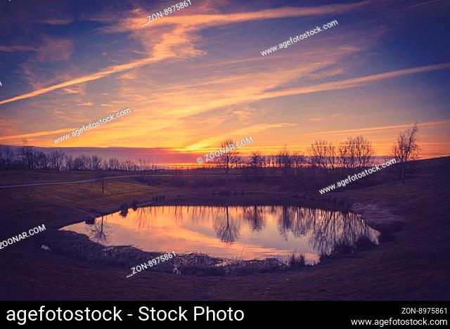 Lake in a beautiful sunset in the autumn