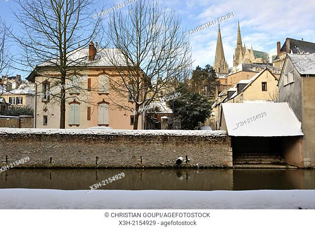 wash house on the Eure River bank with the Cathedral's spires in the background, Chartres in winter, Eure-et-Loir department, Centre region, France, Europe