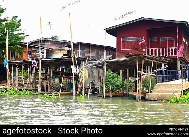Ayutthaya, stilt houses on the Chao Phraya river bank. Phra Nakhon Si Ayutthaya, Thailand