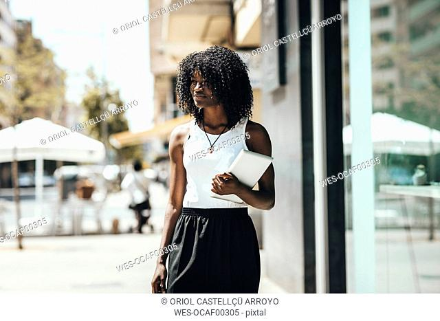 Woman with tablet in the city