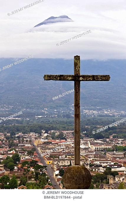 Cross above valley town