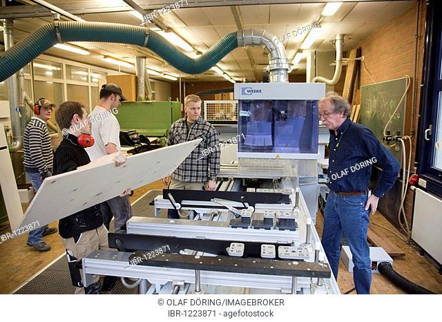 Specialist lecturer demonstrating a computer numerical control (CNC) milling machine, Master Craftman School of the Chamber of Small Industries and Skilled...