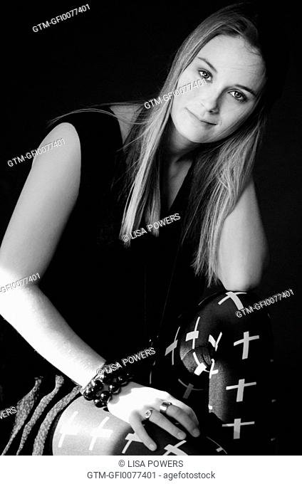 Beautiful young blonde woman wearing goth leggings