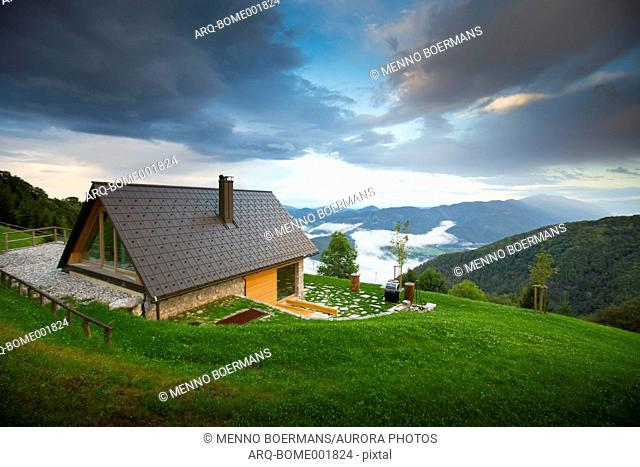 Mountain hut near Tolmin with landscape of valley, Triglav, Slovenia