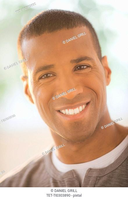 Portrait of young smiling man