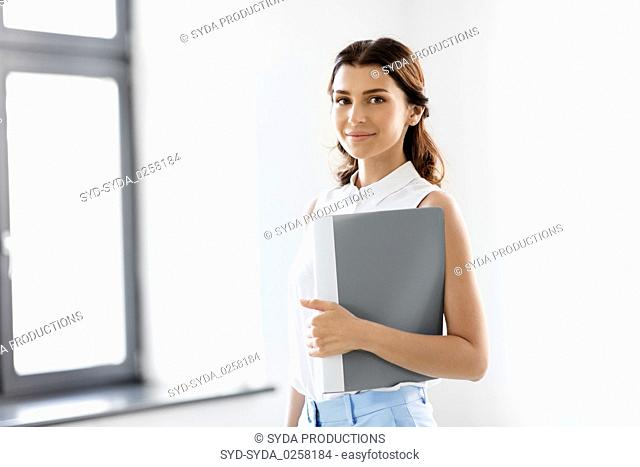 businesswoman or realtor with folder at office