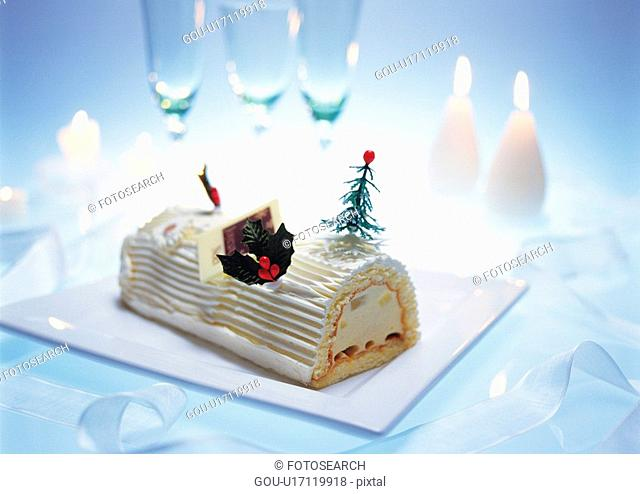 Christmas cake rolled up and covered with cream, Yolu log