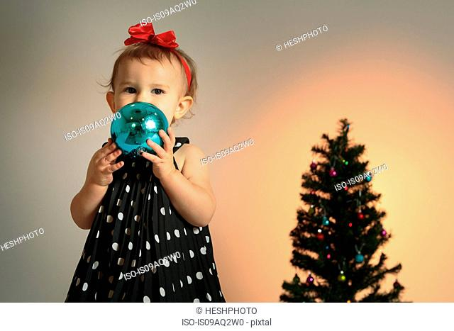 Little girl with christmas bauble