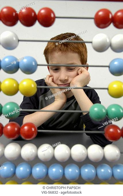 Boy with abacus. - BONN, GERMANY, 15/04/2004