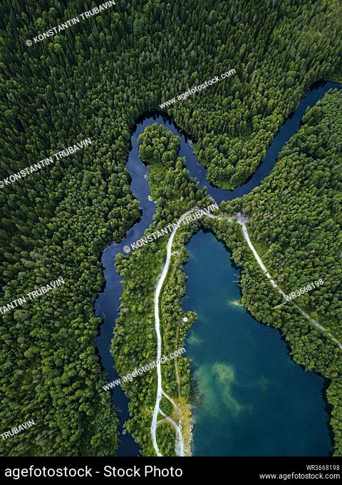 Russia, Republic of Karelia, Sortavala, Aerial view of green forest surrounding country road, Lake Light and Tohmajoki river in summer