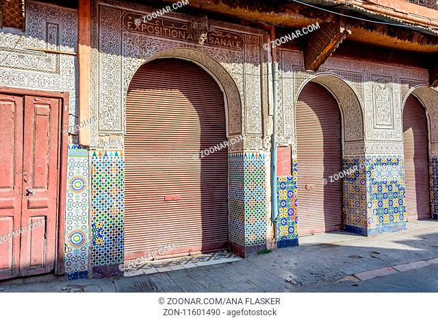 crafted Moroccan door with tiles and patterns, Marrakech, Morocco
