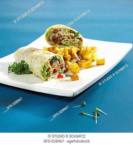 Tuna and avocado wrap with fried diced potatoes