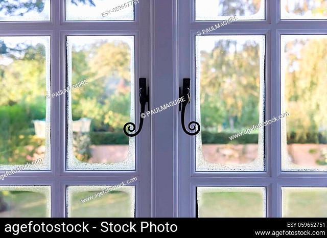 Condensation on double glazed wooden windows due to cold bridging, UK